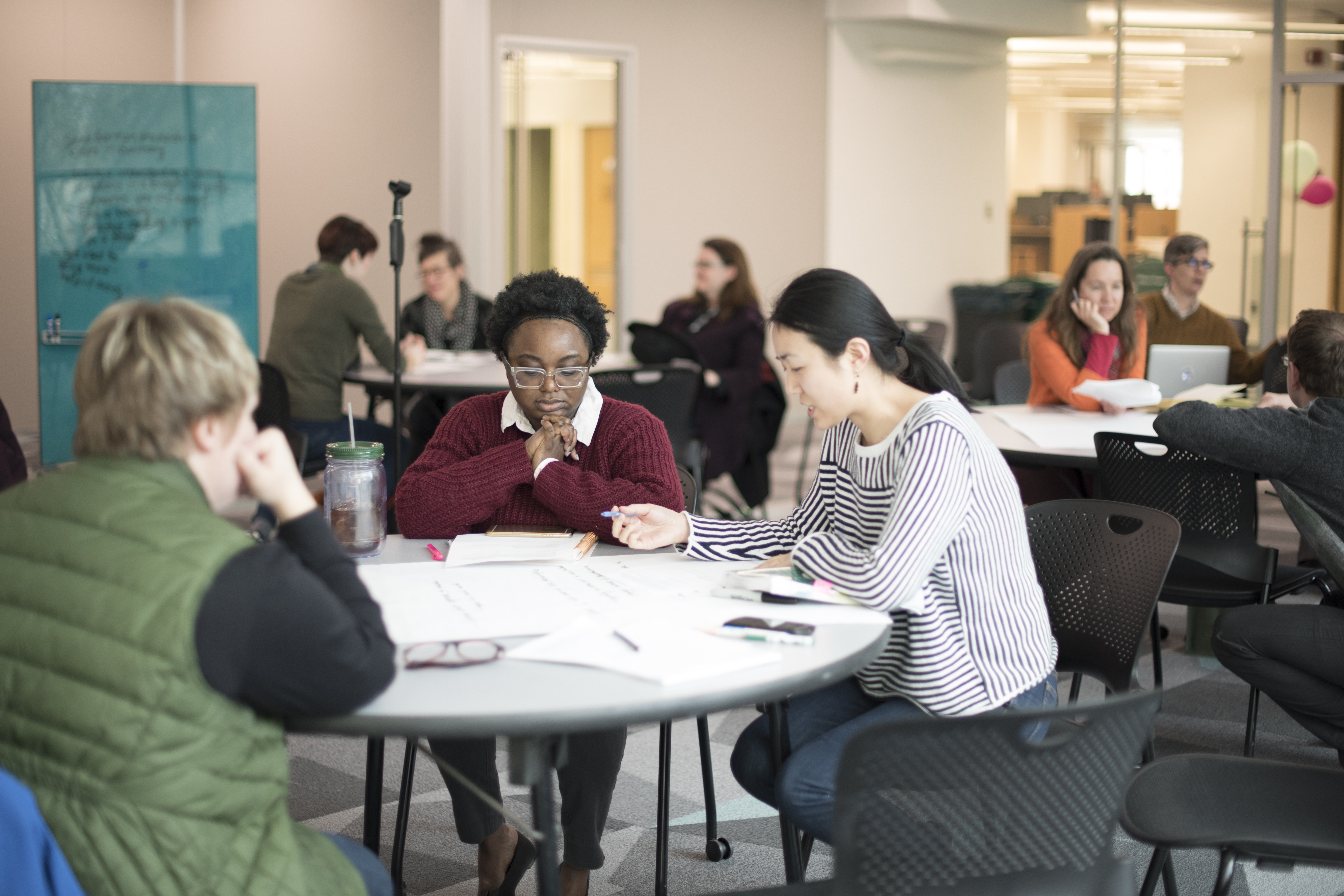 This image shows members of the MSU Libary working at a round table in the Digital Scholarship Lab's Flex Space